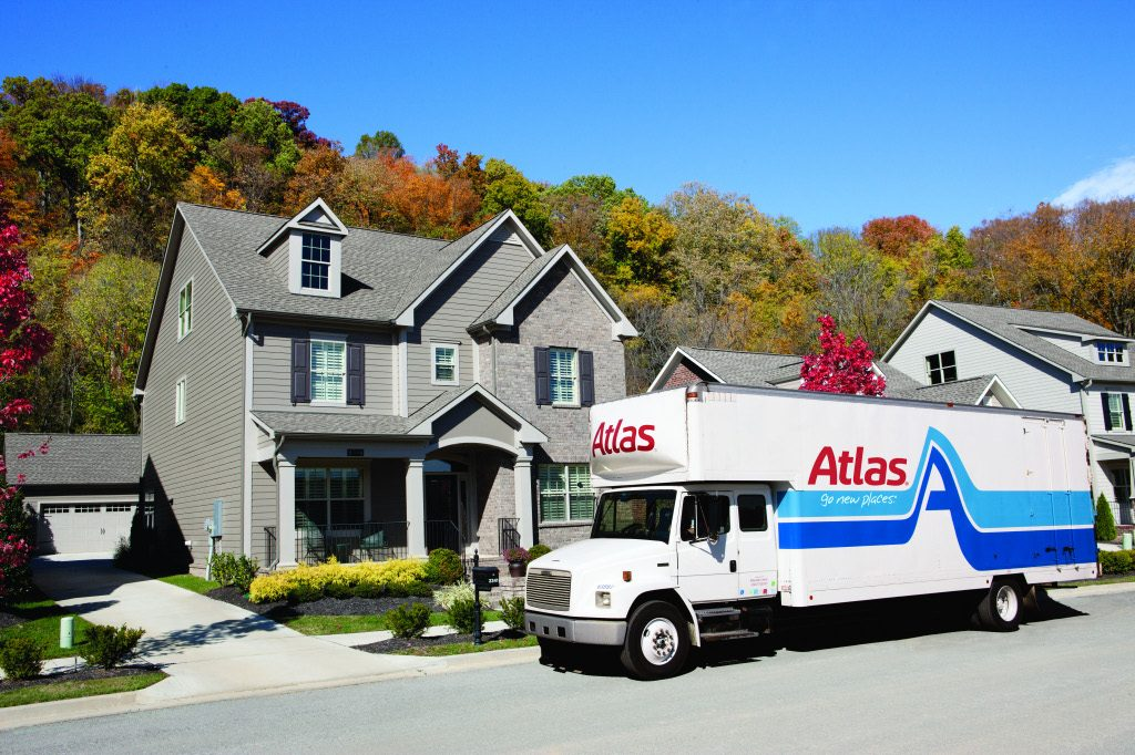 Atlas moving truck parked in front of a house